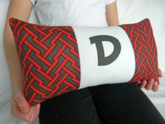 Personalized Modern Red and Grey Geometric Pillow. $27.00, via Etsy.