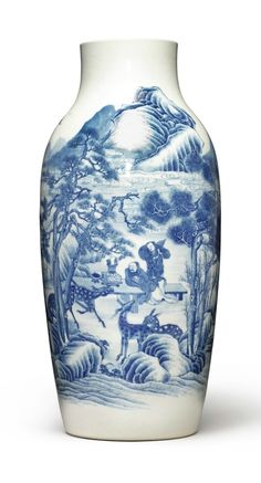 A soft-paste blue and white vase, Qing dynasty, 18th-19th century. Estimate 6,000 — 8,000 USD. Photo Sotheby's  the cylindrical tapering vessel rising from the rounded shoulders to a waisted neck and straight rim, well-painted in varied tones of underglaze blue on a creamy-white ground, depicting a seated sage leaning heavily onto a long painting table, arranged with scholarly objects, a young attendant standing attentively close by, both staring at four deer striding in the foreground, all…