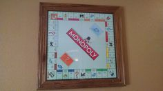 Hanging Monopoly Retro Game Board. Pull them off the wall and play directly on the clear Plexiglas. Created using baseboards, cut to size, then stained. Cut a piece of Lexan Polycarbonate Sheet to size. Screw frame and plexiglas sheet to a piece of plywood cut to size. Add the picture hanging hardware to the back. Add the round felt protective stickers to the back to prevent the scratching of your table.