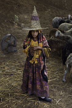 01270_12, Yemen, 03/1997, YEMEN-10201. A girl with a tall hat. retouched_Sonny Fabbri 10/3/2013 Steve McCurry