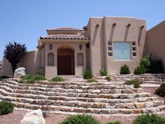 The flat roofs and earth-toned walls of the pueblo style were inspired by the simple structures of the Pueblo Indians.