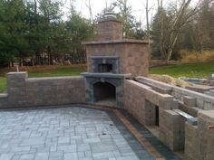 This fireplace is built in to the landscape wall and complements the patio design wonderfully!