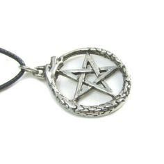 """Oroborus the Snake Pewter Pendant on Cord Necklace, The Wiccan Collection Creative Ventures Jewelry. $11.99. Comes with 33"""" Cord and Story Card. Pendant Comes with a 33"""" Long Cord. Pendant is 1 """" Diameter. Oroborus the Snake Pendant. Lead Free Pewter, Made in the USA"""