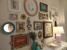 vintage frames. we shopped thrift stores and made these with fabrics, pretty paper, and other finds