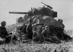 Members of the SS Panzerdivision Hitlerjugend resting by a knocked out Sherman, Battle of Caen, Normandy, july Pin by Paolo Marzioli Les Cents, Sherman Tank, War Photography, Ww2 Tanks, Political Events, German Army, D Day, World History, Military History