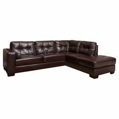 Top-grain leather sofa with hand-tufted back cushions.