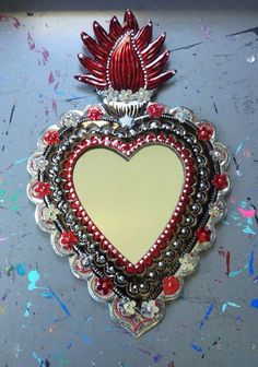 Such a beautiful Mexican piece for your wall! Tin sacred heart mirror with large flames! I have embellished with lots of paint detail, sequins and