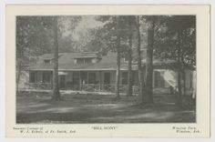 """Postcard of a wide one story cabin with a covered porch. The edge of the postcard describes the scene as """"Summer Cottage of W. J. Echols, of Ft. Smith, Ark. """"Bill-Mont"""" Winslow Park, Winslow, Ark."""""""