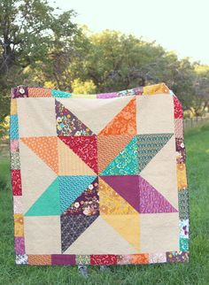 """Easy DIY Star baby quilt tutorials - two versions of a simple design to make a quick quilt. Great for beginners. Uses 10"""" precut (layer-cake) squares.)"""