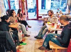 Israelis share a beer at Tel Aviv's first bar-restaurant co-op on http://sizedoesntmatter.com