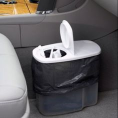 Cereal canister used as a garbage can for the car...