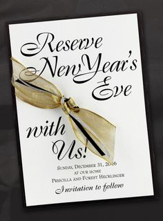 The New Year's Eve countdown will start early with this sophisticated save the date in layers of black and white with just a touch of sparkle in silver & gold ribbon.  www.lallie.com