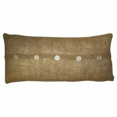 """Adorned with charming button details, this burlap pillow offers rustic appeal for your bed or favorite reading nook.  Product: PillowConstruction Material: BurlapColor: BurlapFeatures: Five buttons sewed down the middleDimensions: 10"""" H x 20"""" WCleaning and Care: Dry clean only"""