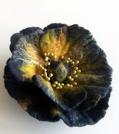 "Felt flower brooch Poppy , Felt Jewelry, Wool Flowers, Felted Brooch, ""A little bit different poppy"". $19.00, via Etsy."