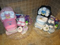 Boy and girl twin diaper carriage cakes for baby shower.