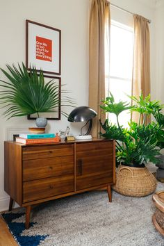 Mid-Century Media Console - So much great design by @oldbrandnew in this tiny New Orleans living room