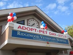 The banner for Ridgewood Veterinary Hospital's 7th Adopt-A-Pet Day.