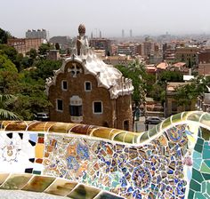 Park Güell - Gaudí's Park Güell is most famous for its distinctive mosaic benches which curve along the edge of the upper section of the park. This close up shows just how much color and design is on every inch of the benches. The effect one gets up close is entirely different from further back.