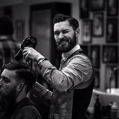 Cool! A barber for starters, with a sweet hint of a handlebar at that. Reminds me of that Val Kilmer as Doc Holiday line 'you may proceed sir'. You?