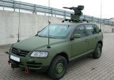 Oh wow. Didn't see that one coming. VW Toureg Mil Spec with turret