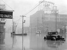 Louisville, Kentucky, Great Ohio River Flood © Margaret Bourke-White, 1937.   Bourke-White's classic Great Depression photograph was originally only one of many images she made while covering a far more particular, localized catastrophe: namely the devastating Ohio River flood of 1937, which claimed close to 400 lives and left roughly one million people homeless across five states in the winter of that terrible year.