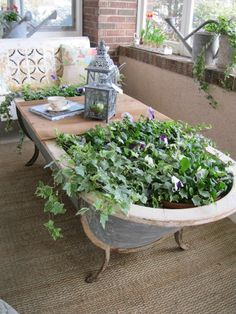 Old Bathtub turned coffee table/planter! via the Garage Sale Gal I actually have an old claw foot tub in my barn, I was thinking of making it into a small koi pond, but I think I like this coffee table/planter better for our vacation home. Garden Tub, Garden Cottage, Dream Garden, Home And Garden, Garden Planters, Porch Planter, Herb Garden, Recycled Planters, Porch Garden