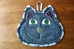 Happy Cat insulated quilted pot holder by BlueberryHillQuilts, $18.00.  Take any potholder design and make a mug rug.