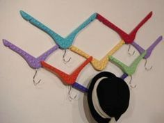 Upended hangers, painted different colors, make a geometric set of hooks.