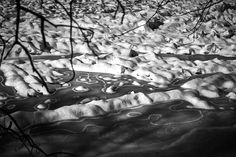 Melting ice on St-François river in Sherbrooke QC - Melting ice cover makes strange patterns on St-François river in Sherbrooke QC.