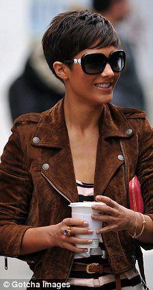 short hair, bomber jacket, glasses