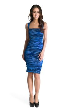 Nicole Miller - Square Neck Sheath -- a ruched dress meant for elegance but depending on size can seem a tad hoochie. Pair with pumps and few accessories.