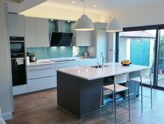Proof that blues, greens and greys don't have to be cold. This palette combination creates a fantastic, light yet warm and inviting space. #German #Kitchens #LavaGrey #LightGrey #Silestone #BlancoZeus #Farrow&Ball #Splashback #Neff #Appliances