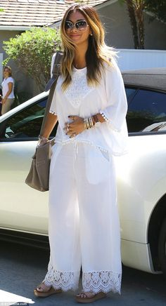 Dressed to impress: The 37-year-old singer opted for a boho babe vibe for her ensemble, br...