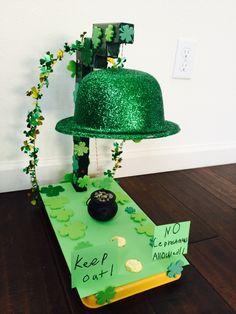 Connor's Leprechaun trap. The hat comes down when you move the pot of gold.