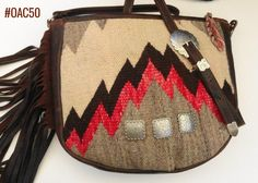 Large saddle bag made of fine leather and fragment of vintage Navajo rug.  Produced in the U.S. A.  Find more designer handbags at www.pccohandbags.com