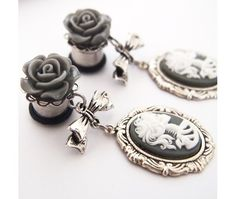 wish i still had my ears stretched sometimes... //  00g 10mm Grey Skeleton Woman Steel Dangle Plugs - Shop Gauges/Plugs  Tunnels at RebelsMarket on We Heart It. http://weheartit.com/entry/45216808