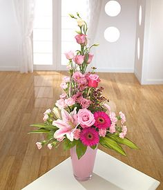 A modern tall container arrangement featuring pink Roses, pink Carnations, Lilac and Lisianthus. Flowers are arranged in Oasis floral foam. Rosen Arrangements, Church Flower Arrangements, Church Flowers, Beautiful Flower Arrangements, Funeral Flowers, Silk Flowers, Spring Flowers, Floral Arrangements, Beautiful Flowers