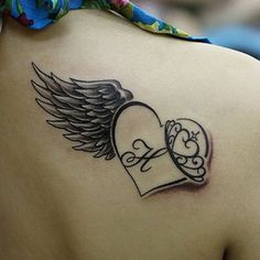 Wing and heart tattoo - 35 Breathtaking Wings Tattoo Designs