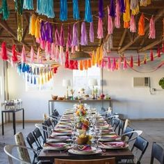 Look up! Hanging colorful tassels from the ceiling brightens up the whole day.Related: 50 Decadent Ceilings That'll Blow Your Guests Away