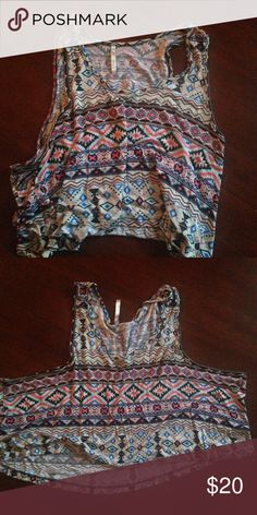 Aztec muscle tank Never worn. Low cut a holes. Vibrant pattern. Urban Outfitters Tops Muscle Tees