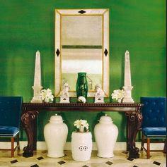 Miles Redd - Glazed wall (persimmons), console, long mirror, side chairs covered in different color