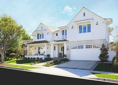 White Exterior Color Schemes. White home exterior with gray front door, black lantern and front porch. White Exterior Paint Color. #WhiteExterior #PaintColor #WhiteHomeExterior  William Guidero Planning and Design.