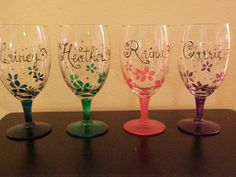 DIY: hand painted wine glasses,  names but different designs at bottom. This same idea for guys shot glasses.