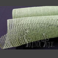 """All Mint Burlap Mesh Combination of poly mesh and jute threads Color: Mint Green Poly, Mint Green Jute Size: 10"""" width; 10 yards length"""