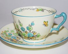 Rare - Antique CROWN STAFFORDSHIRE England Bone China, TeaCup and Saucer and was commissioned by Henry Birks & Sons Ltd..(Canada) c1930's
