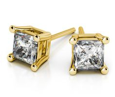 These modern princess cut diamond stud earrings are held in a yellow gold four-prong setting. Each diamond weighs 2 carats, for a total diamond weight of 4 carats.