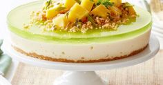 Invite your family and friends over for this delicious no-bake cheesecake, made with an irresistible Anzac biscuit base and topped with fresh mango and passionfruit.