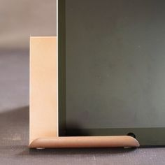 Make this beautiful Brushed Metallic Rose Gold DIY iPad Holder! It literally only cost a few dollars to make and is so stunning!