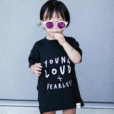 """Kids gender neutral slogan """"Young Loud & Fearless"""" tshirt in black by Kidult & Co in the UK. End of stock from online stre. All tees are brand new. As featured in UK Vogue edition."""