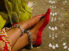 Indian Woman with Alta / Mahawar on Feet (organic red dye which women apply with cotton on the border of their feet during marriages and religious festivals.)